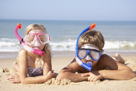 snorkelling: Young children on beach holiday