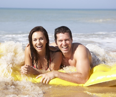 Young couple on beach holiday photo
