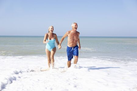 Senior couple on beach holiday Stock Photo - 9195266