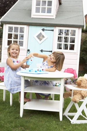 girl party: Two young girls play outdoors