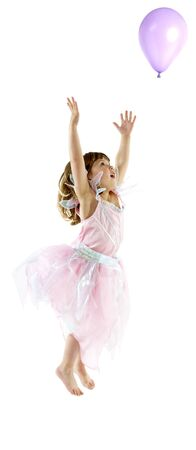 Young girl celebrates in studio photo