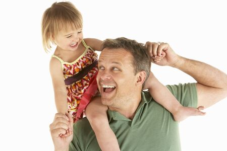 Young man carries child on shoulders Stock Photo - 9195268