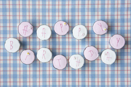 Cupcakes spell out happy birthday Stock Photo - 9197741