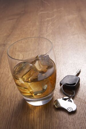 A glass of alcohol and car keys photo