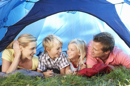 Young family poses in tent photo