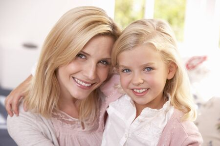7 year old girl: Woman and child pose in studio Stock Photo