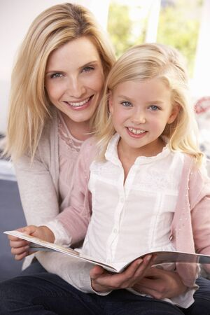 Woman and child reading together photo