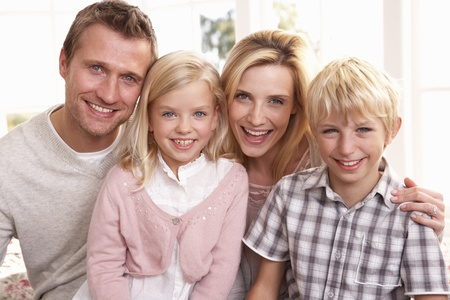 thirties portrait: Young family pose together