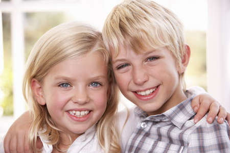 7 year old boys: Two young children pose together; Stock Photo