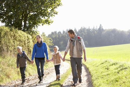 countryside: Young family walking in park