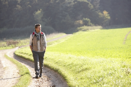 alone: Young man walks in park Stock Photo