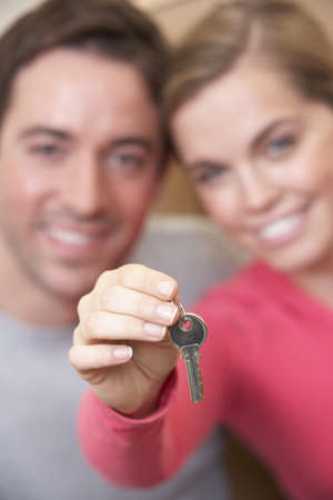 Young couple holding key in hand Stock Photo - 9875549