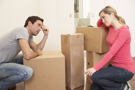thinking out of the box: Young couple looking upset among boxes Stock Photo