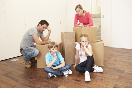 Young family looking upset among boxes Stock Photo - 9875925