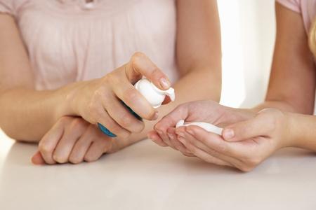 sanitizer: Woman hand applying hand sanitizer Stock Photo