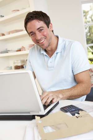 Young man working with laptop computer Stock Photo - 9875520