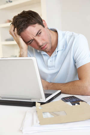 Young man working with laptop computer Stock Photo - 9875545