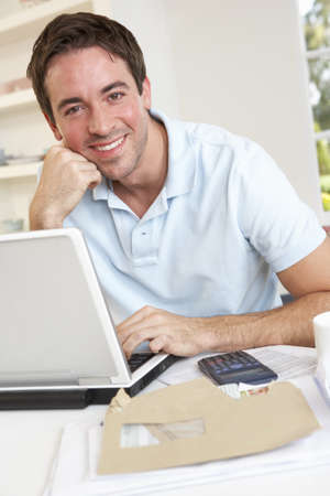 Young man working with laptop computer Stock Photo - 9875575