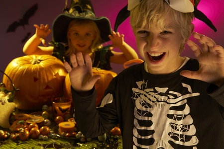 trick or treating: Halloween party with children wearing scaring costumes Stock Photo