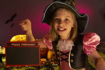 Halloween party with a child holding sign in hand photo