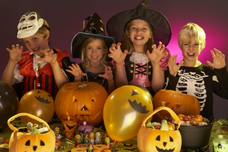 trick or treating: Halloween party with children wearing fancy costumes
