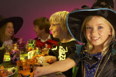 trick or treating: Halloween party with children having fun in fancy costumes Stock Photo