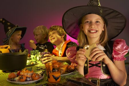 fancy dress costume: Halloween party with children having fun in fancy costumes Stock Photo