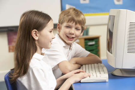 Schoolchildren In IT Class Using Computer photo