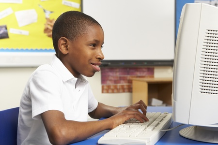 Schoolboy In IT Class Using Computer Stock Photo - 9875583