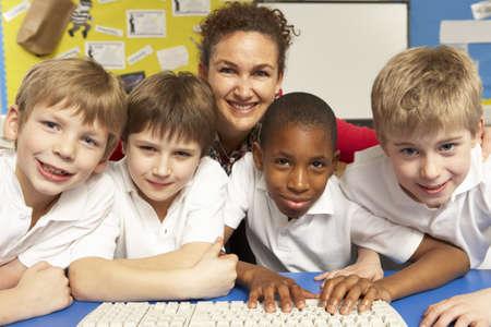 schoolchildren: Schoolchildren in IT Class Using Computers with teacher