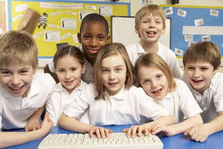 multiracial children: Schoolchildren in IT Class Using Computers
