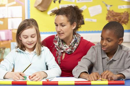 schoolchild: Schoolchildren Studying in classroom with teacher