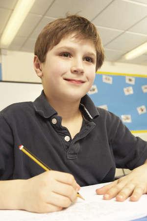 non uniform: Schoolboy Studying In Classroom