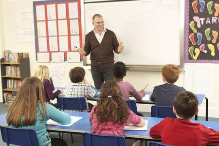 schoolchildren: Schoolchildren Studying In Classroom With Teacher