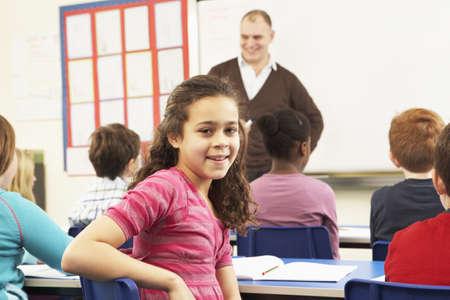schoolkid: Schoolchildren Studying In Classroom With Teacher
