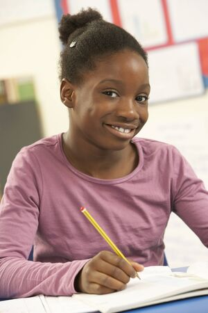 Schoolgirl Studying In Classroom Stock Photo - 9875668