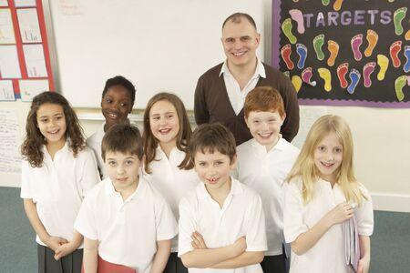 9 year old girl: Portrait Of Schoolchildren Standing In Classroom
