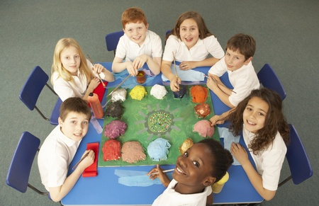 Overhead View Of Schoolchildren Working Together At Desk Stock Photo - 9875977