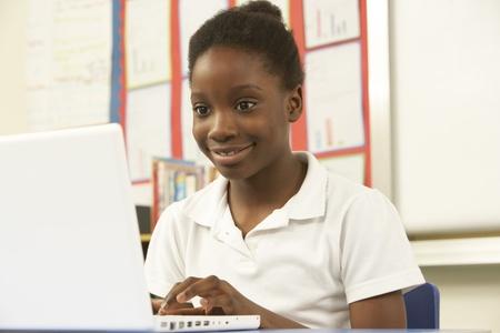 using computer: Schoolgirl In IT Class Using Computer Stock Photo