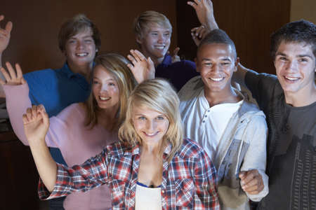 Group Of Teenage Friends Dancing And Drinking Alcohol photo