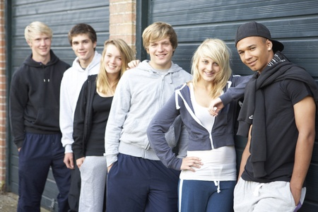 Group Of Teenagers Hanging Out Together Outside photo