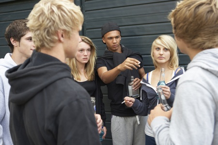 Group Of Threatening Teenagers Hanging Out Together Outside Drinking Stock Photo - 9875779
