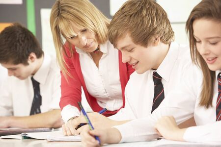 Teenage Students Studying In Classroom With Teacher Stock Photo - 9875482