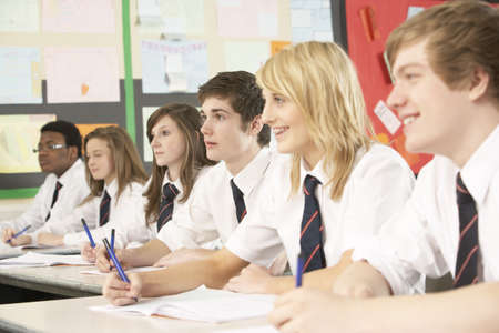 secondary school: Teenage Students Studying In Classroom