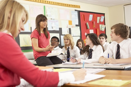 Teenage Students Studying In Classroom With Teacher And Assistant Stock Photo - 9875679