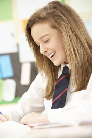 uniform student: Female Teenage Student Studying In Classroom