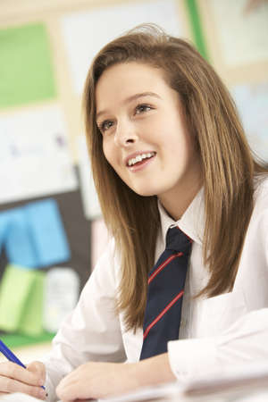 secondary school: Female Teenage Student Studying In Classroom