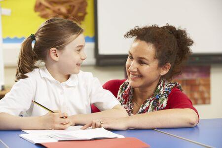 schoolgirls: Schoolgirl Studying In Classroom With Teacher