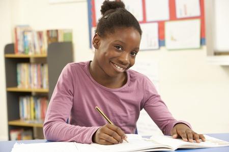 junior education: Schoolgirl Studying In Classroom