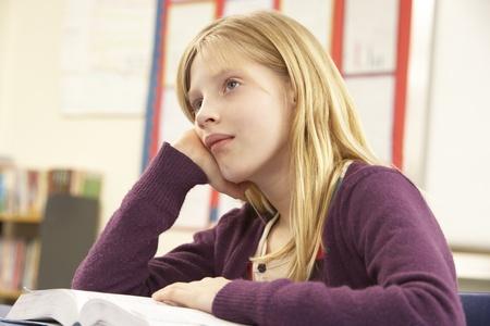 year old: Schoolgirl Studying In Classroom